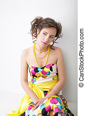 Art portrait of young pretty woman in colorful bright dress