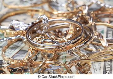 Jewelry - Close up photo of golden bracelet and other...