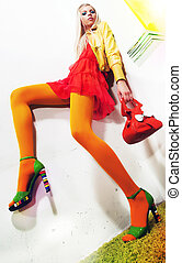 Beauty - lovely young female blonde fashion model sitting -...