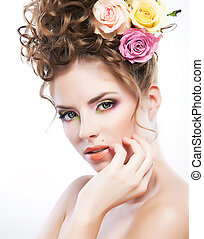 Art portrait of a beautiful young woman with fresh flowers -...