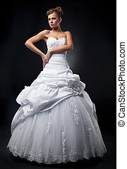 Luxurious fiancee super model shows white wedding dress -...