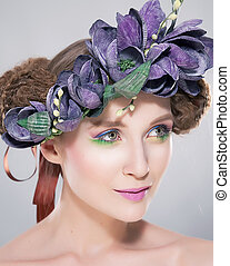 Beauty - young hairstyle model in colorful wreath of flowers closeup art portrait. Series of photos