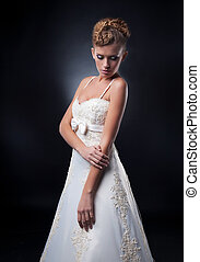 Fashion young woman posing in white nuptial dress - Wedding...