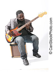 bass player - an american african bass player on white...