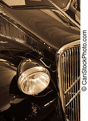 An antique car - One of the front light of an antique car