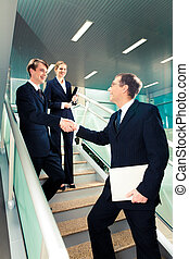 Congratulations - Handshake of business partners on the...