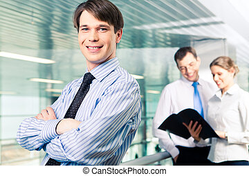 Confident manager - Portrait of smiling professional looking...