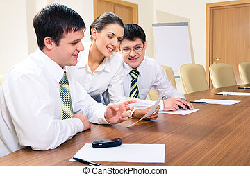 Business team at work - Photo of two men sitting at table...