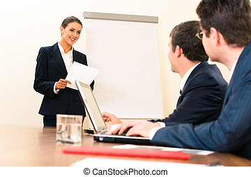 Making report - Portrait of smiling manager standing at...