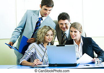 Computer work - Photo of confident people looking at laptop...