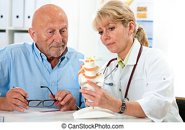 Medical exam - Physical therapist talking to patient and...