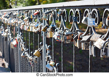 padlocks - Many different locks hung on a bridge. These...