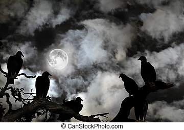 Vultures silhouetted against a full moon and spooky sky -...