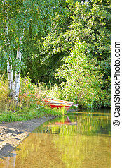 lake shore - Boat on the lake shore in Finland