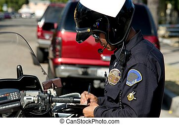 Traffic stop - a motorcycle police officer writing a ticket...