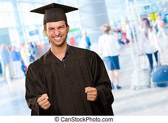 Young Man In Graduation Gown, Indoor