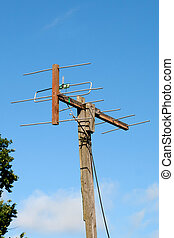 self-made TV antenna against blue sky