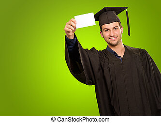 Graduate Man Holding Blank Card On Green Background