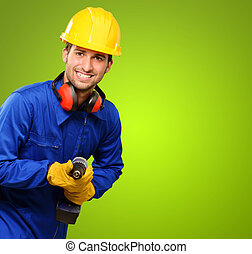 Engineer Holding Drill Machine On Green Background