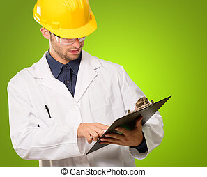 Architect Holding Writing Pad On Green Background