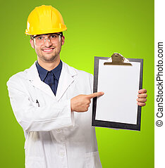 Architect Pointing On Writing Pad On Green Background