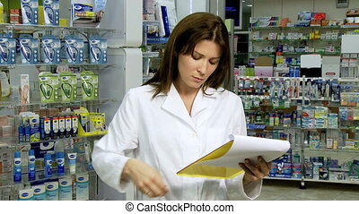 pharmacist arguing on the phone - Beautiful woman pharmacist...