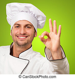 Portrait Of Chef Showing Ok Sign - Chef Showing Ok Sign On...