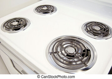 electric stovetop - A white electric stove with four...