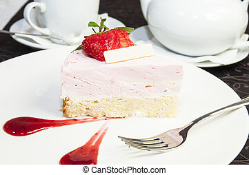 cream pie - piece of cream cake on a white plate in a...