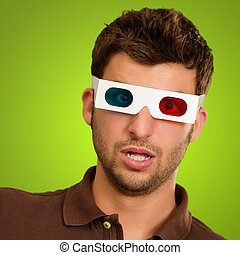Portrait Of A Young Man Wearing 3d Glasses On A Green...