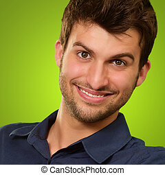 Close-up Of A Happy Young Man Isolated On Green Background