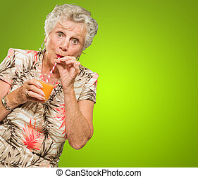 Shocked Senior Woman Drinking Orange Juice