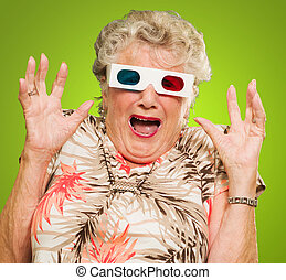 Afraid Senior Woman Wearing 3d Glasses Isolated On Green...