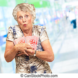 Senior Woman Holding Popcorn