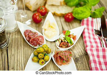 deliscious antipasti plate with parma parmesan olives on...