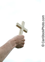 Hand with cross over the sky