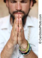 Praying hands closeup