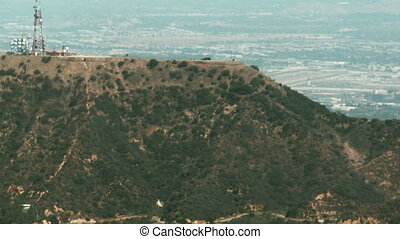 Aerial, Hollywood Sign 01 - Aerial view flying from West to...