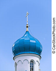cupola - Blue cupola of the church with gold cross against...
