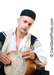 Drum player - Iranian man playing a traditional drum