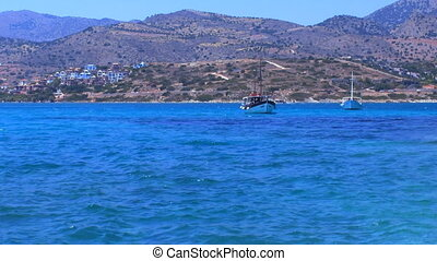 Hills, Boats and Road on the sea shore, Crete