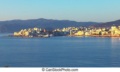 Aerial view of city Agios Nikolaos after sunrise, Crete