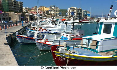 Boats in harbor near Venetian Fortress Koules, Heraklion,...