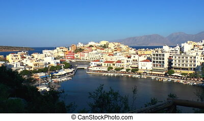 Aerial view of city Agios Nikolaos before sunset, Crete