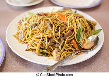 Plate of stir-fried chow mein at a Chinese restaurant