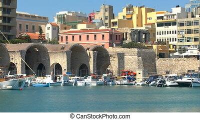 Boats in harbor near Venetian Fortress Koules, Heraklion,...