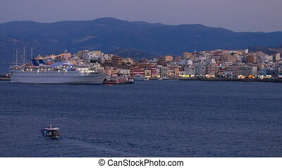 Evening view of Agios Nikolaos city across the bay, Crete