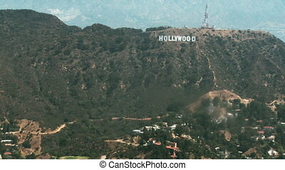 Aerial Hollywood Sign 03 - Aerial view flying from East to...