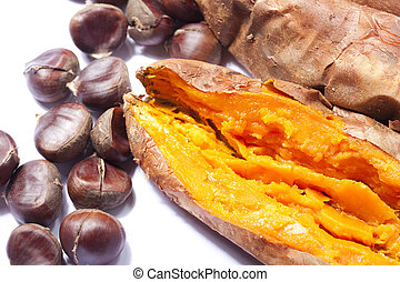 Roasted chestnuts and sweet potatoes - Close up of a...