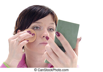 Young woman put a make-up on face - Young woman put beauty...